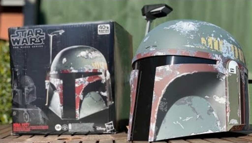 Boba Fett helmet and box side by side