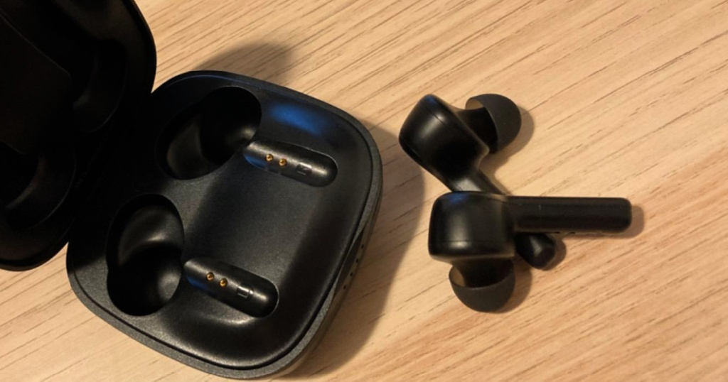 Boltune Wireless Earbuds with Charging Case on wood table