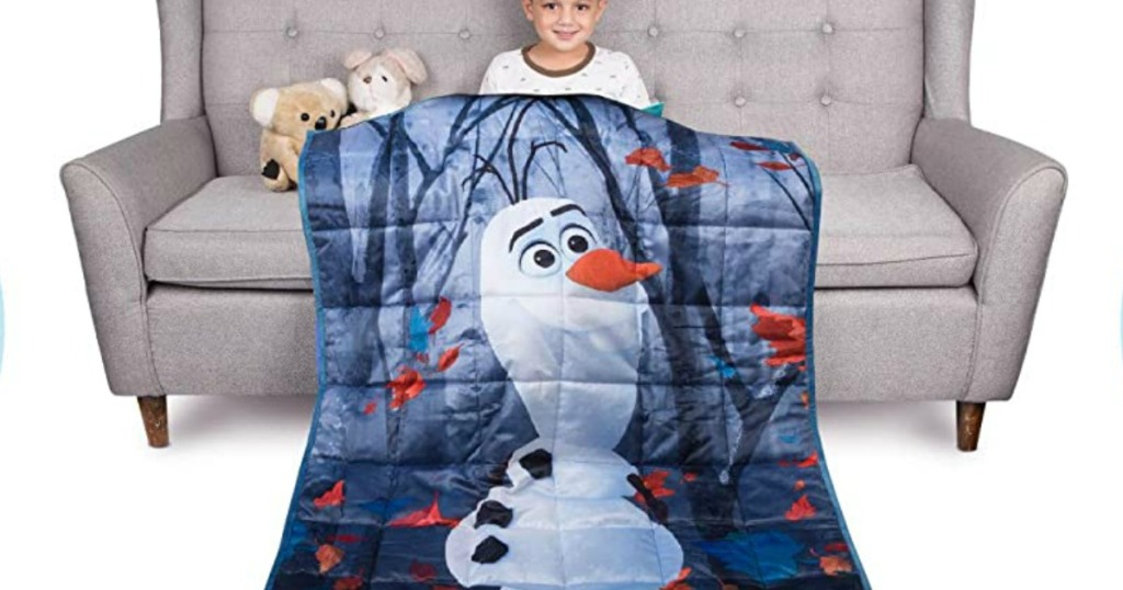 Boy wearing Olar Weighted blanket