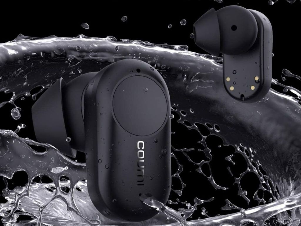 pair of black wireless earbuds with water splashing around them