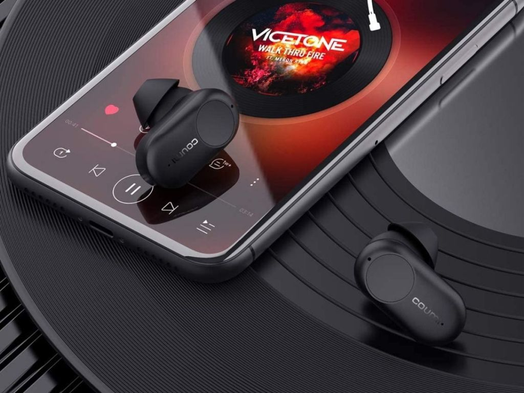 black wireless earbuds with phone nearby
