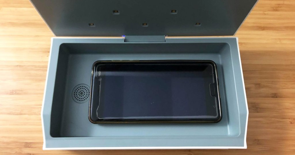 inside view of cahot sanitizing box with black smartphone inside