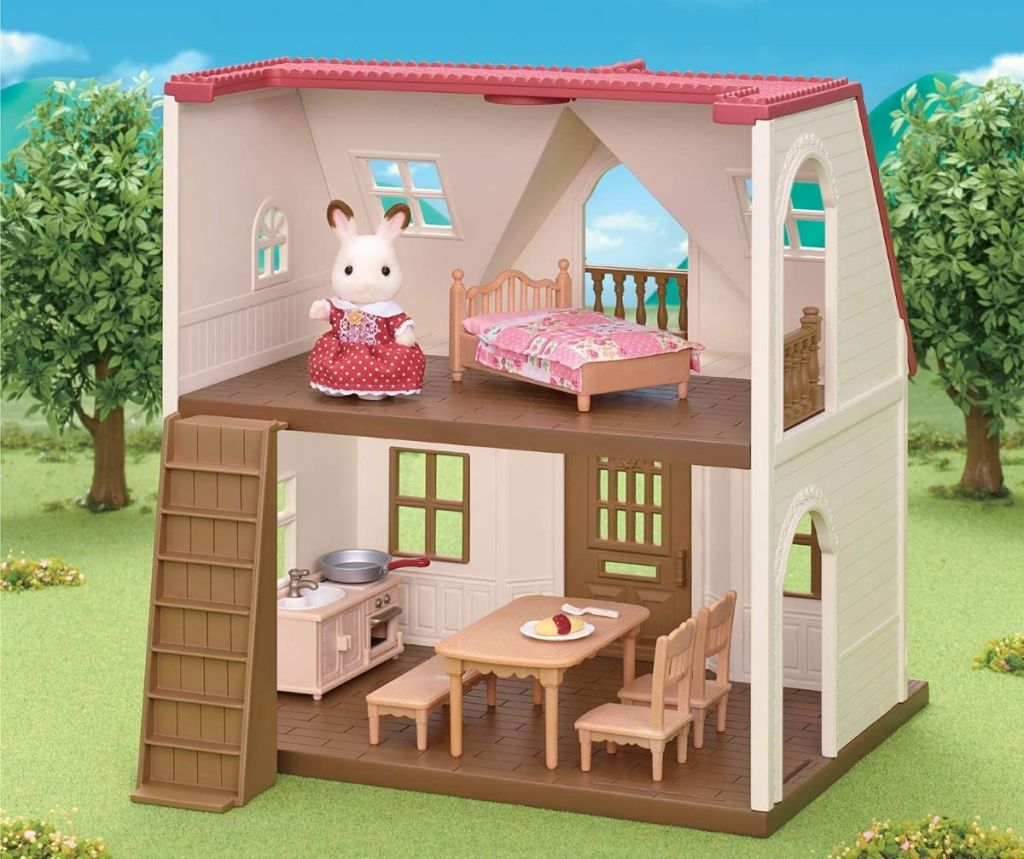 Calico critter toy in a cottage