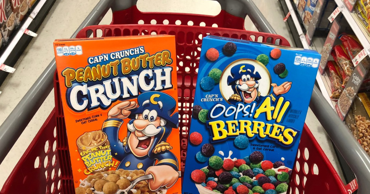 two boxes of cereal in red store cart