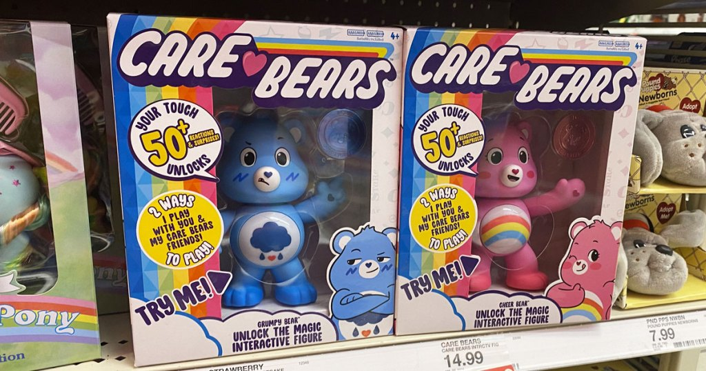 blue and pink care bears interactive toys in retro packaging on target shelf