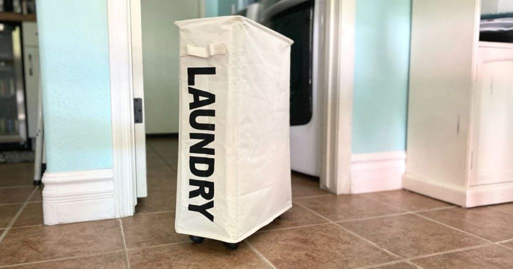 slim laundry bag on wheels sitting in middle of room