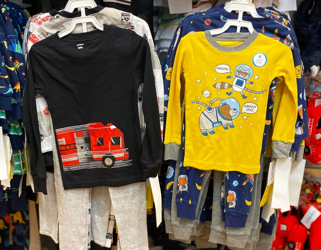 fire truck and space theme boy's carter's pajama sets on hangers