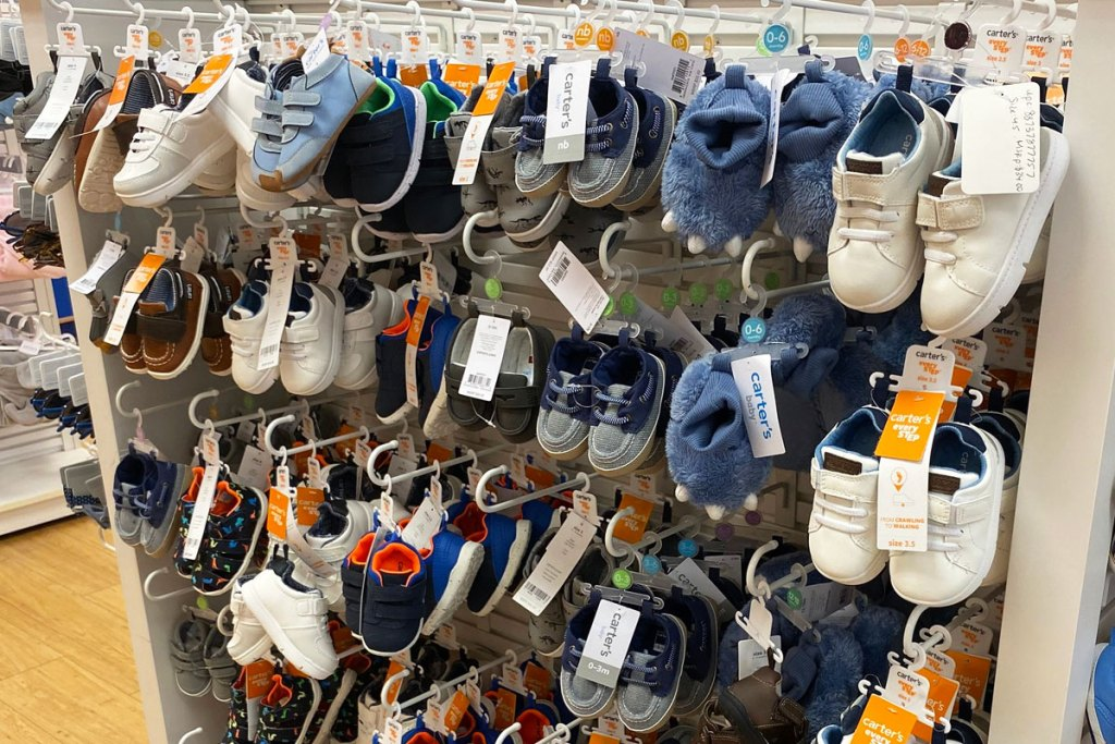 various pairs of baby boys shoes on display at carter's