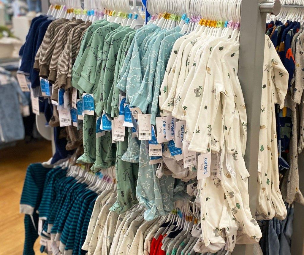 carter's zip-up onesies on store display