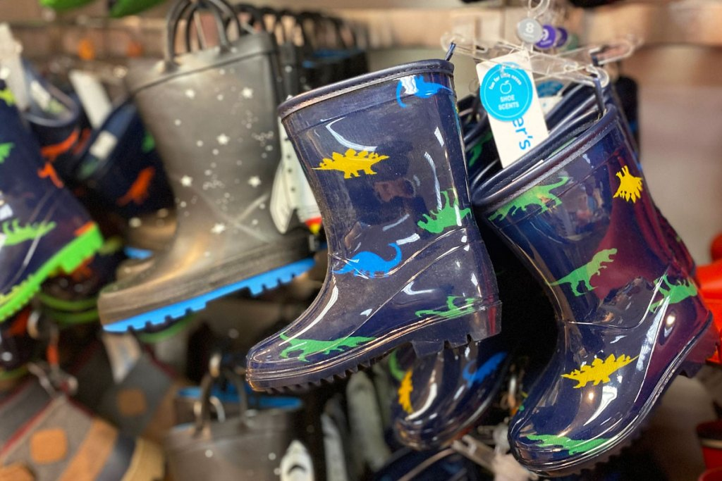 pairs of printed boys rain boots on carter's store display