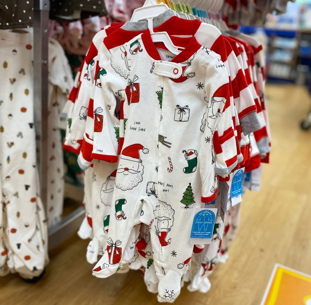 red and white carter's christmas pajamas on hanger
