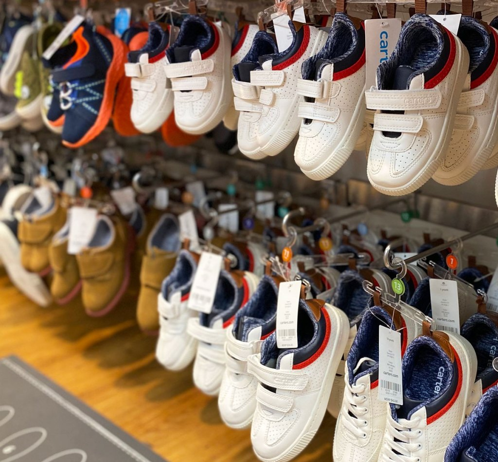 pairs of white velcro boys sneakers on display at carter's