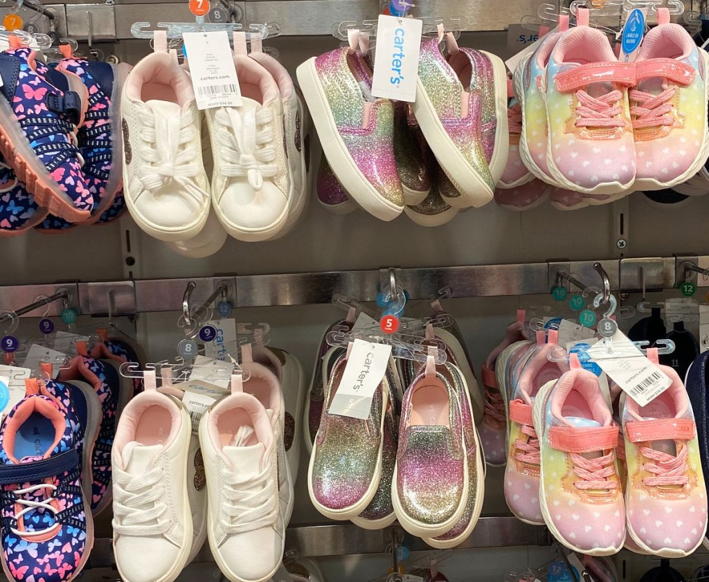 various pairs of girls sneakers on display at carter's