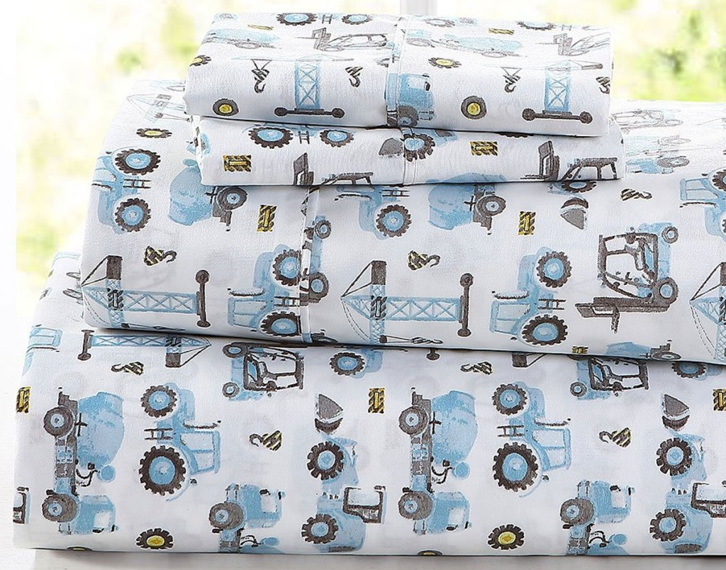 folded sheet set with blue and grey construction vehicle print