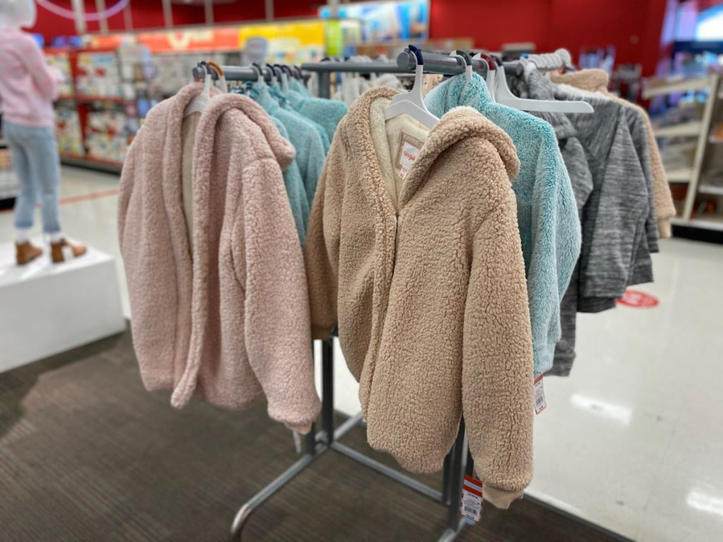 display of jackets hanging on a rack at Target