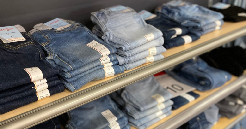 girls jeans stacked on a store shelf at target
