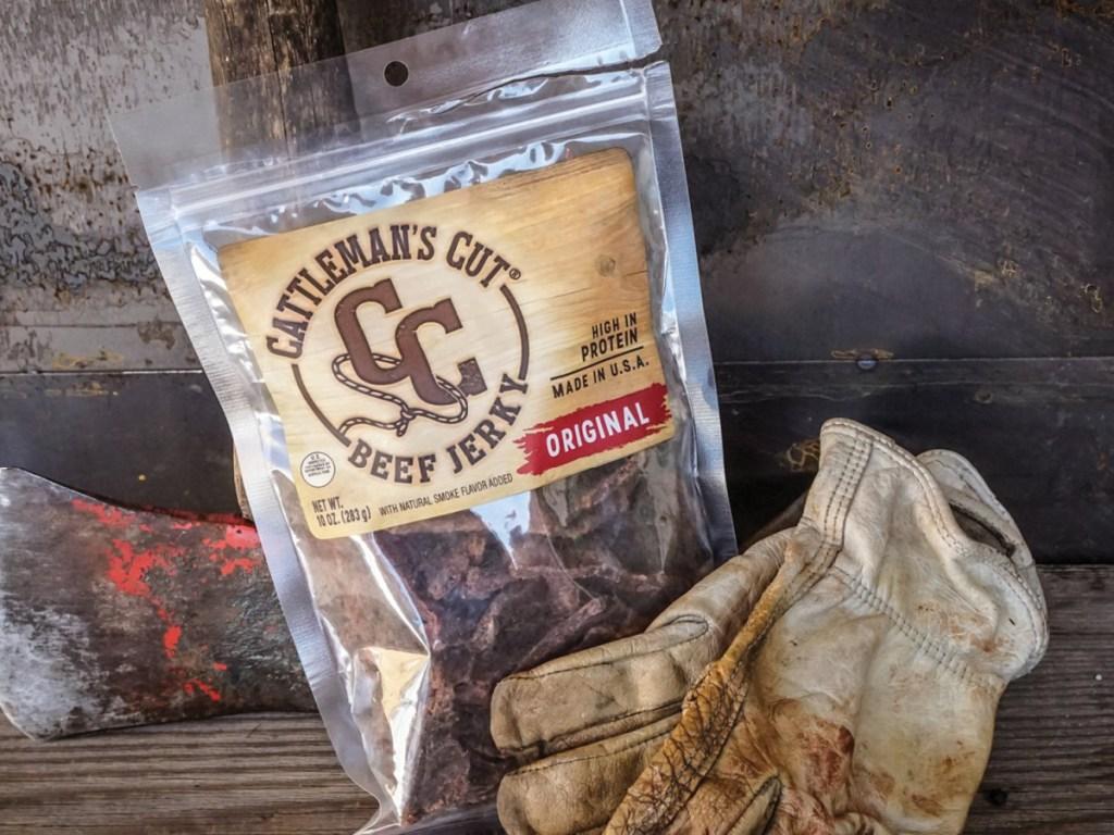 cattleman's cut original beef jerky bag sitting next to a pair of work gloves