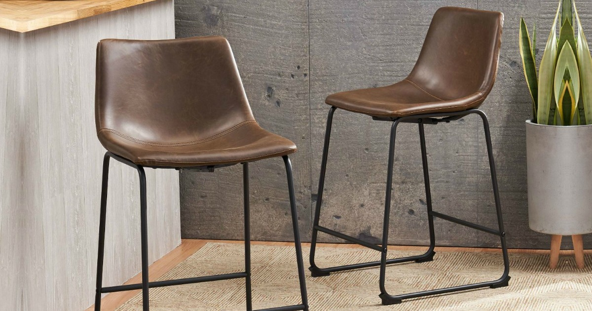 two brown counter stool chairs