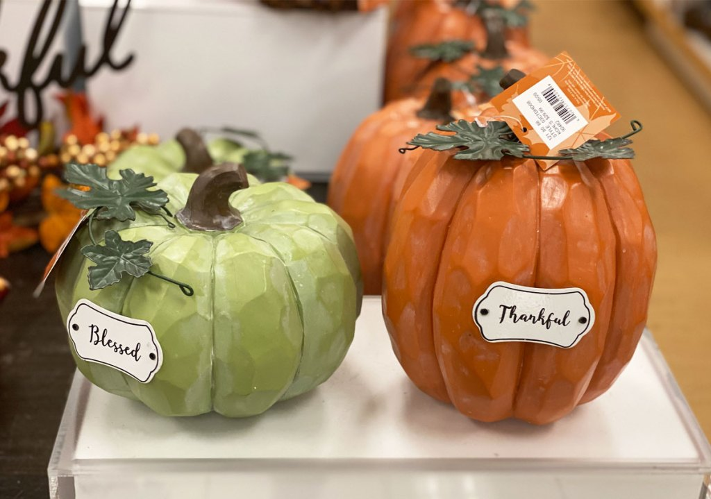 green and orange wooden pumpkins on display at kohl's
