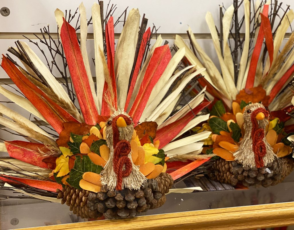 two turkey decorations made from corn husks and pinecones on display at kohl's