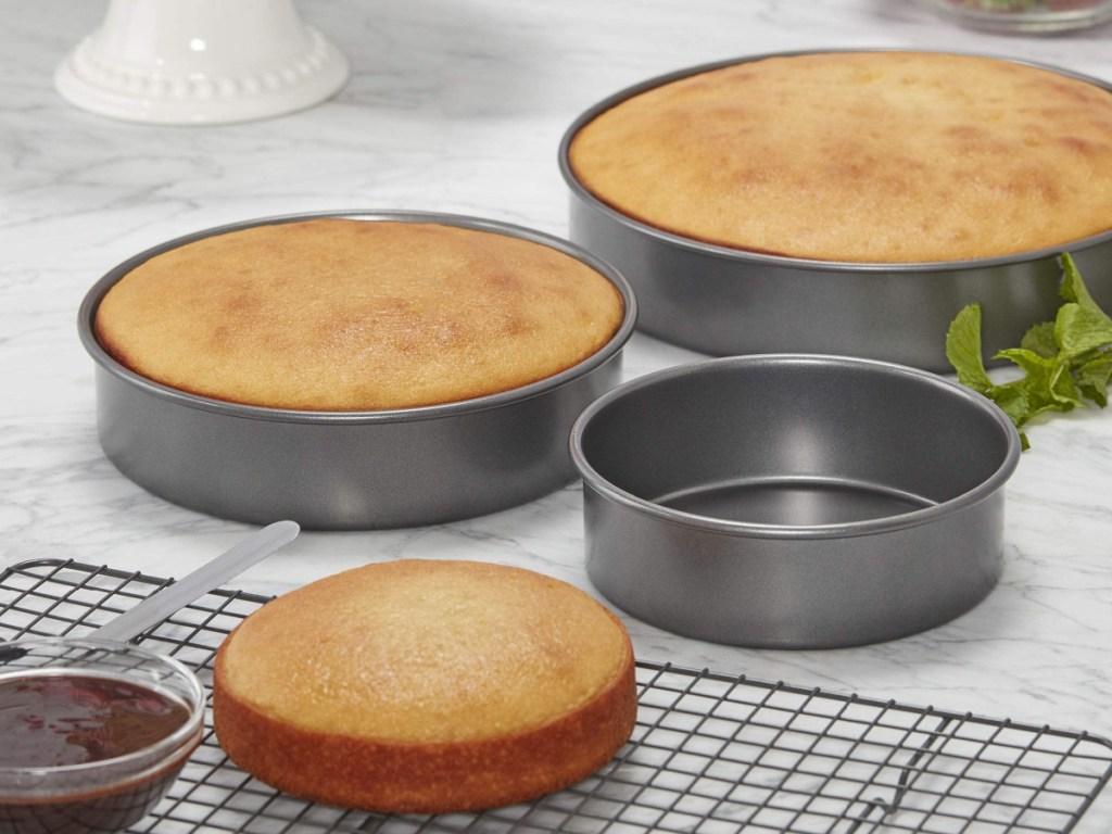 Chicago Metallic Bakeware round baking cake pans set of 3 wth freshly baked cake sitting on a counter