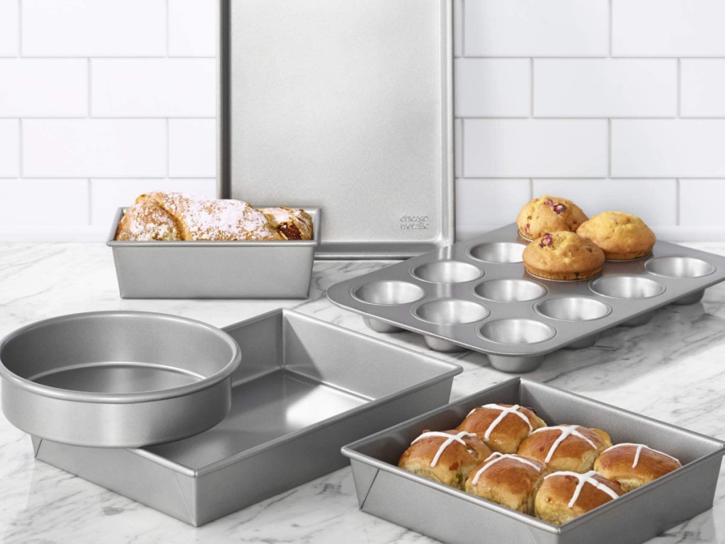 chicago metallic professional bakeware set sitting on a kitchen counter with fresh baked sweets