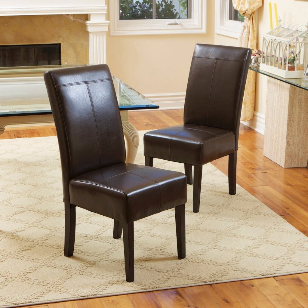 two Christopher Knight Home T-Stitch Dining Chairs in brown in dining room
