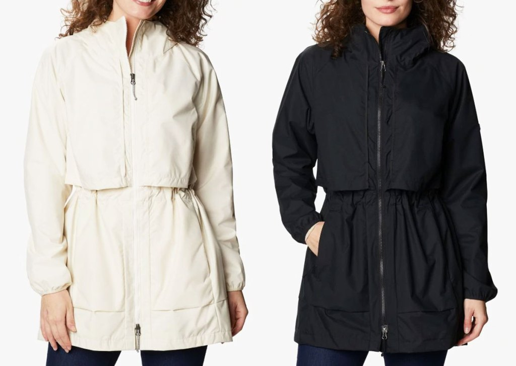 two women modeling longer columbia jackets with cinch waists in cream and black colors