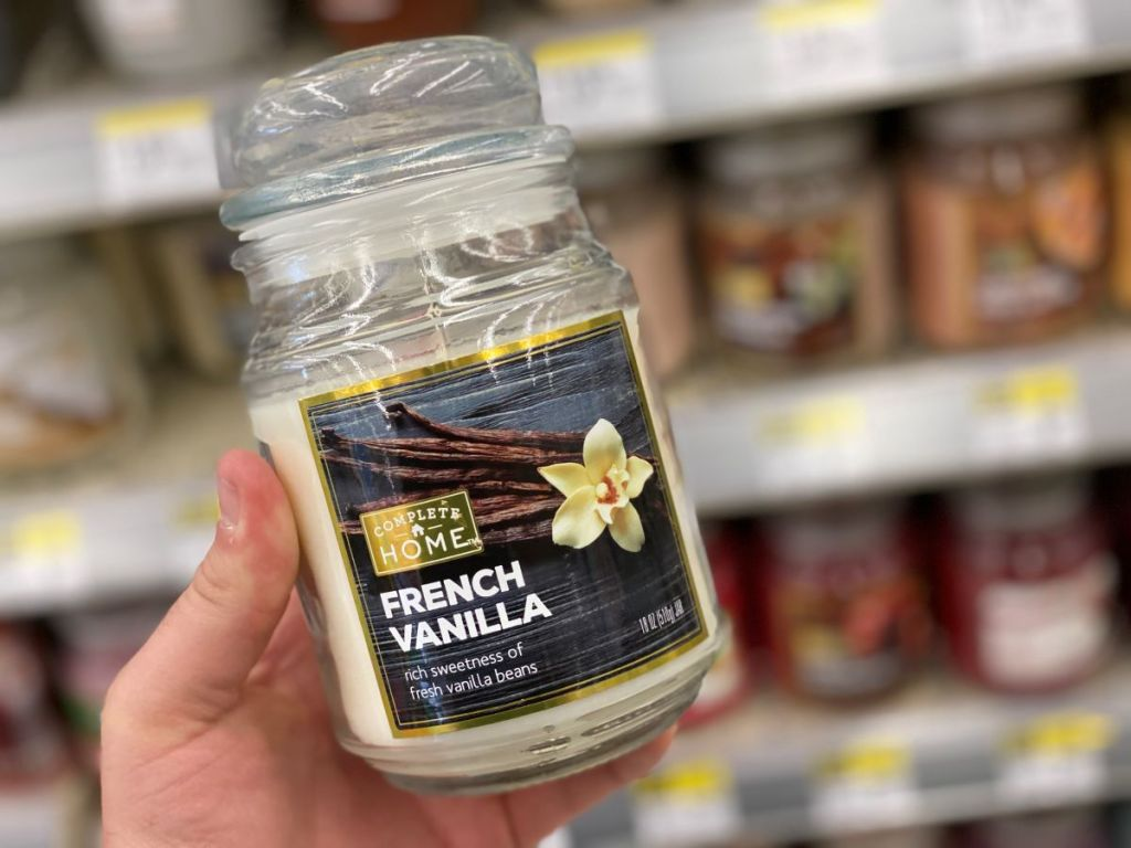 hand holding a jar candle
