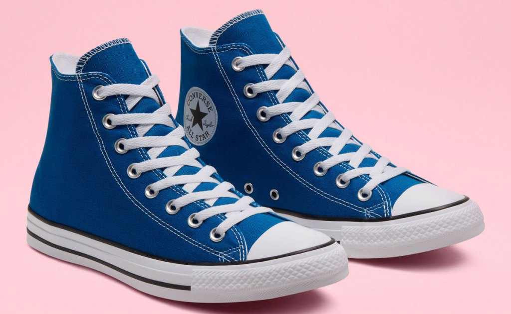 pair of blue high top converse sneakers