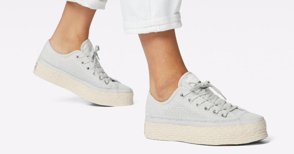 person wearing white/natural espadrille shoes