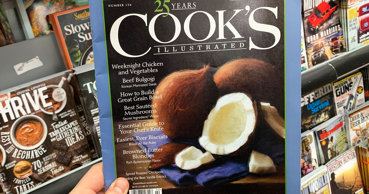 person holding up an issue of cooks magazine with coconuts on front cover
