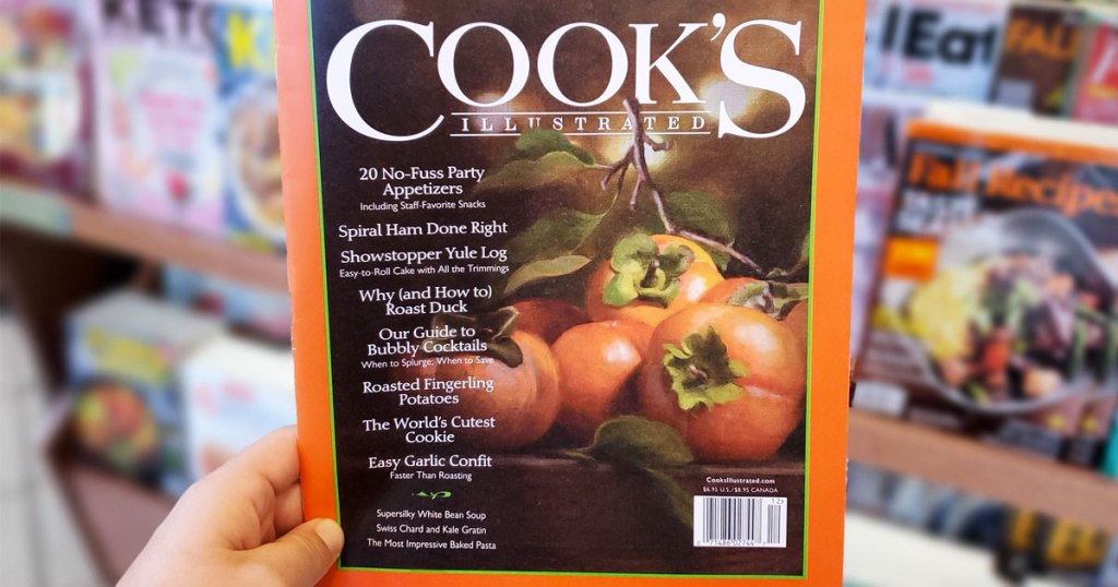 person holding up fall copy of Cook's Illustrated magazine
