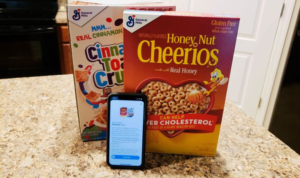 phone leaning against a box of Cheerios