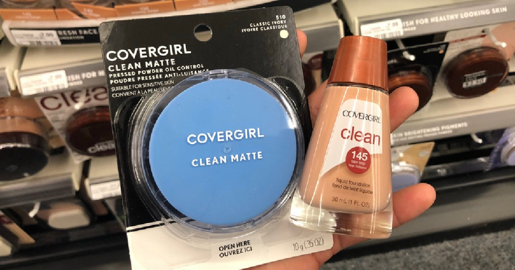 hand holding pressed powder and foundation in store