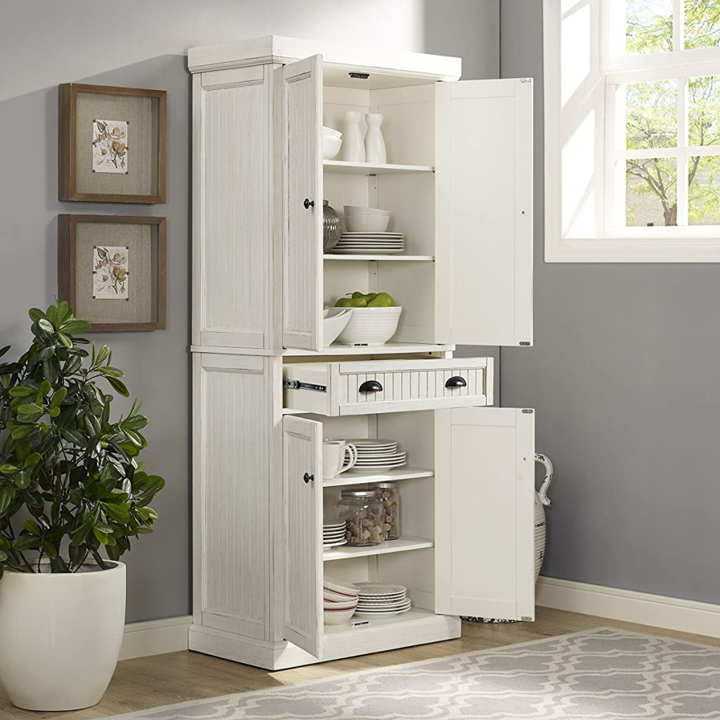 large kitchen cabinet with doors and drawers open