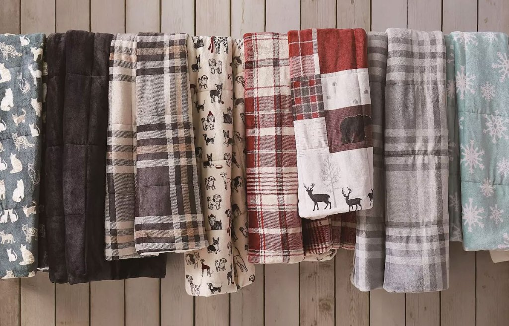 cuddl duds plush throw blankets hanging on line