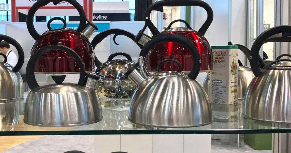 stainless teel tea kettles on store display shelf