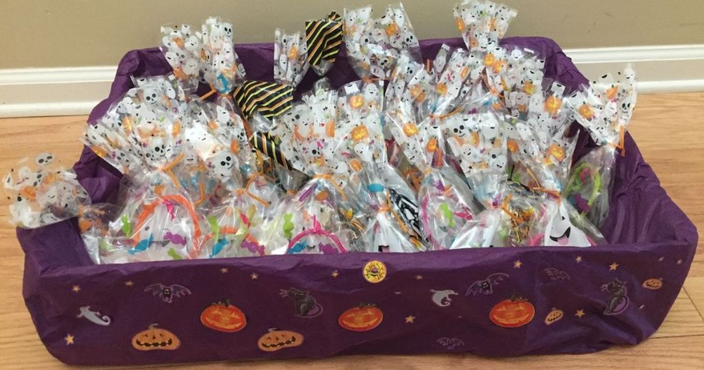 box covered with purple tissue paper, Halloween stickers and filled with festive goodie bags