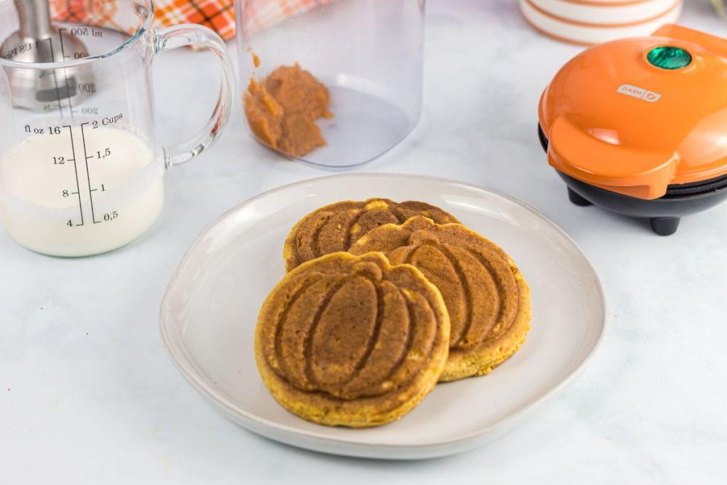 pumpkin shaped waffles on a plate