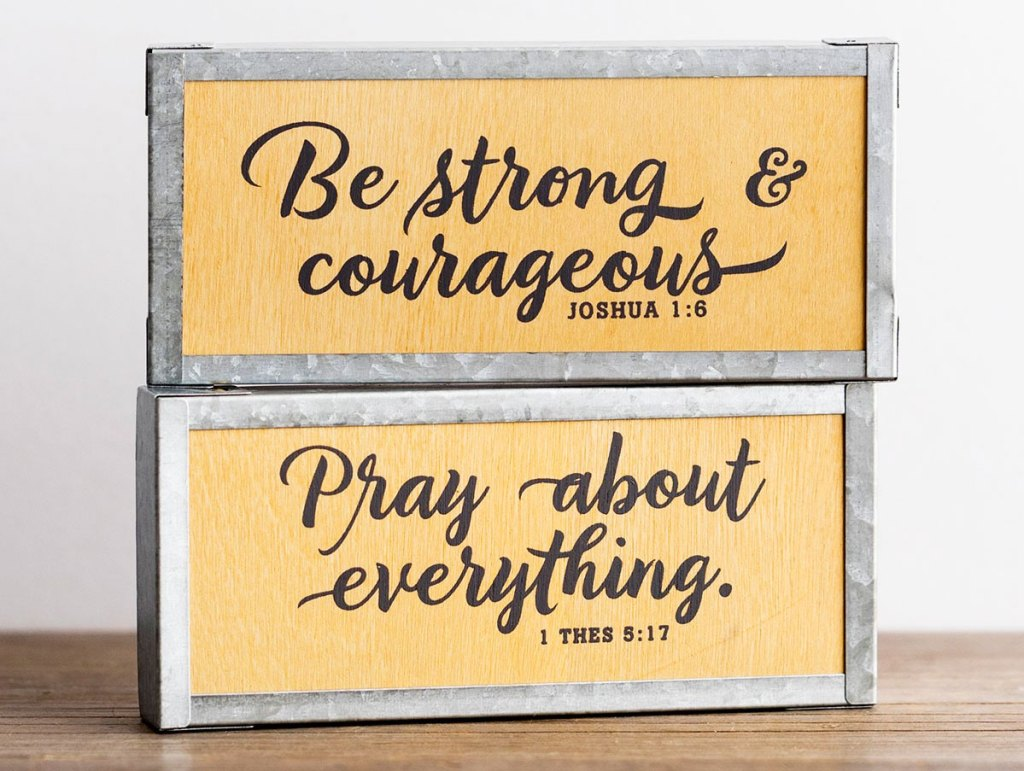 two wood and metal inspirational wall plaques
