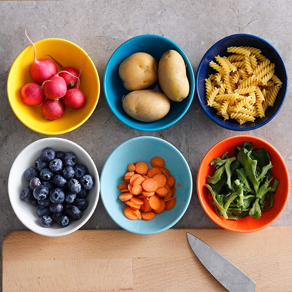 six bowls with different foods in them