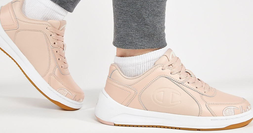 woman wearing a light pink pair of Champion shoes