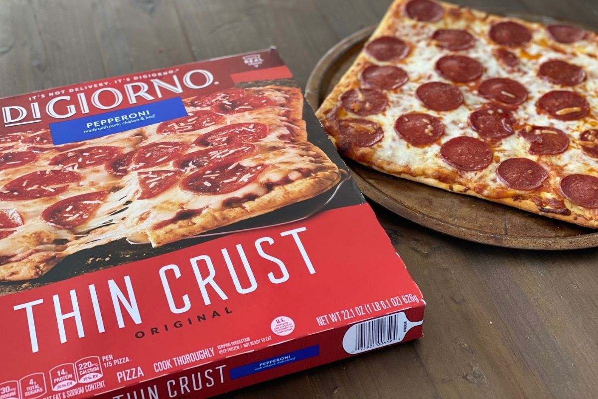 digiorno pizza on a table next to the box