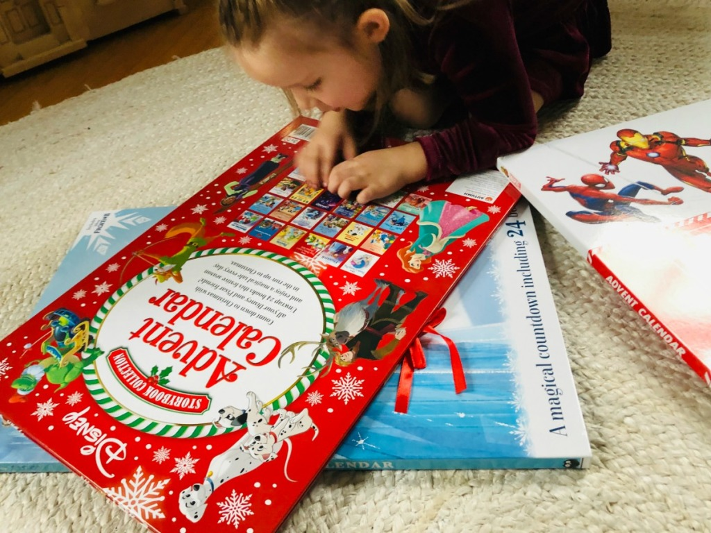 little girl looking at Disney Advent Calendar