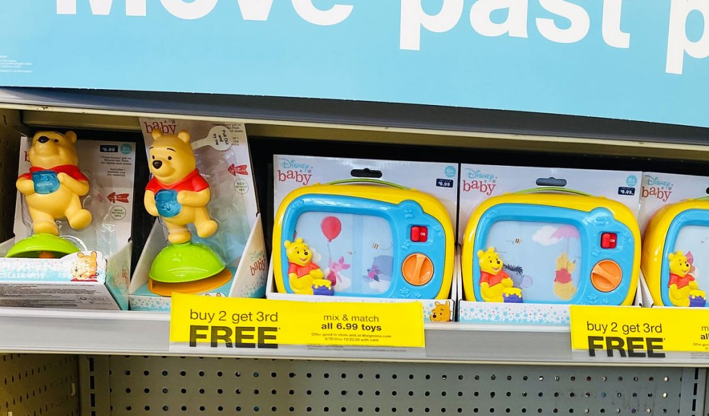 disney baby toys on walgreen shelf with yellow buy 2 get 3rd free sale sign