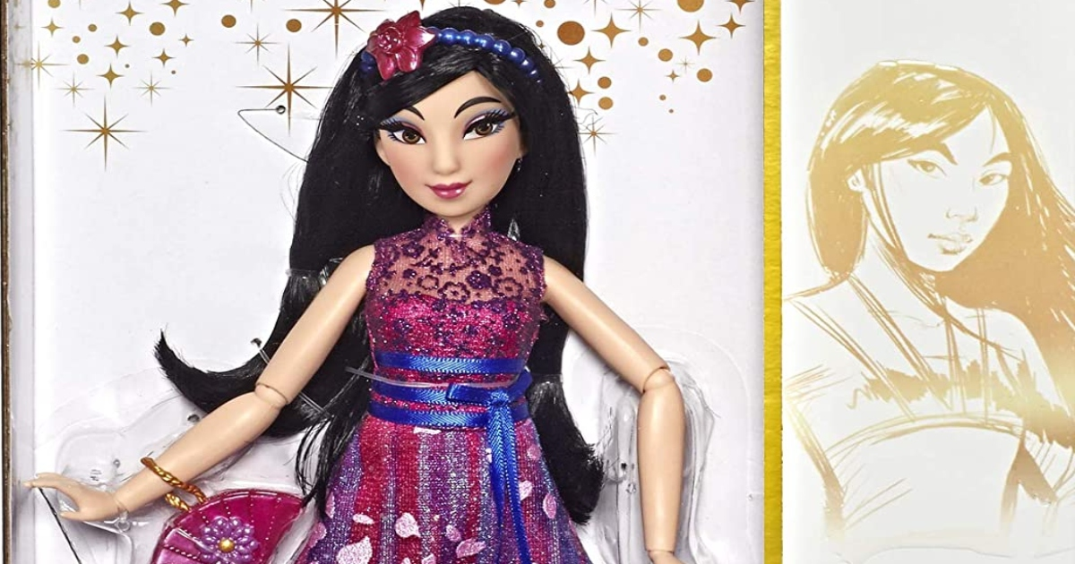 close up of the top have of the Disney Princess Mulan barbie doll with dark hair and a purple dress