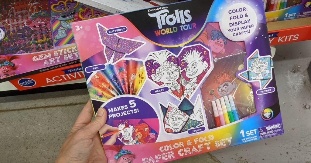 Trolls craft kit box held by hand