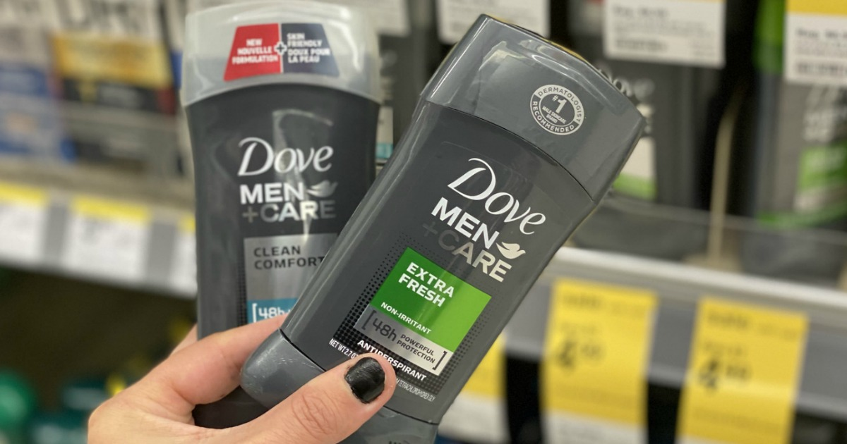 hand holding two Dove Men Care Deodorants in store