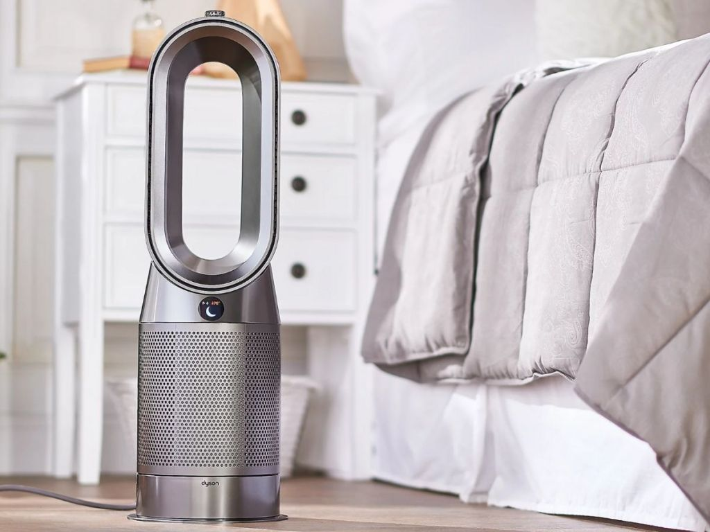 Dyson silver air purifier on floor in bedroom